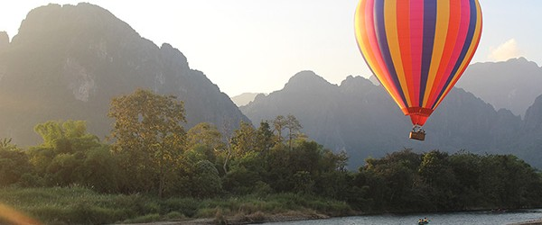 A hot air balloon over the town of Vang Vieng