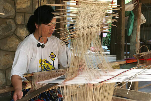 A-woman-weaving-at-village-of-Ban-Phanom