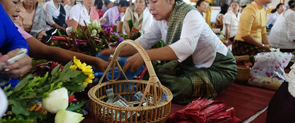 During festival, Laos devotees also make offerings at local temples.