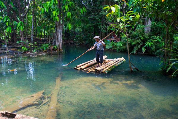 Man rafting near the Kuang Si Waterfall