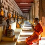Monk worshiping in Wat Si Saket, Laos Tours