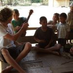 tourists are playing with local children, Tour in Laos