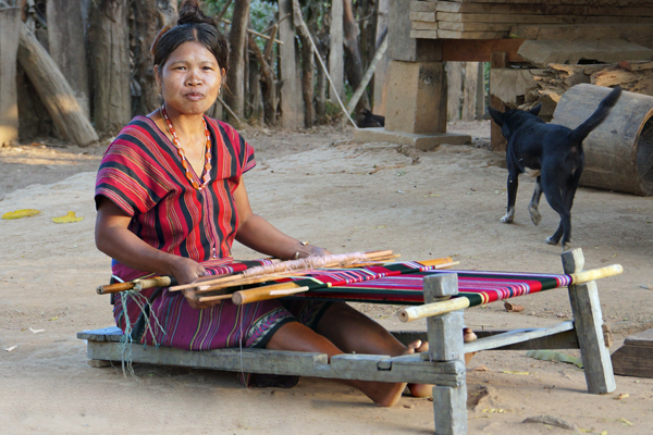 Woman weaving in Alak village