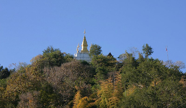 A temple on the top of Mount Phousi mountains of laos