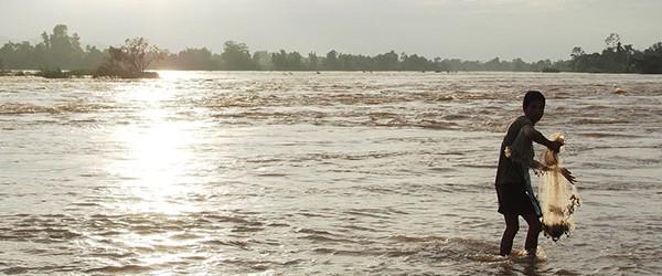 Laos fisherman catch fish in the Mekong river