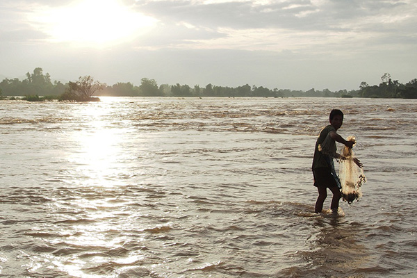 fisherman catch fish in the Mekong river in Laos