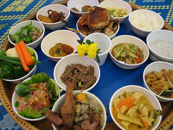 Traditional Laotian food served on bamboo tray
