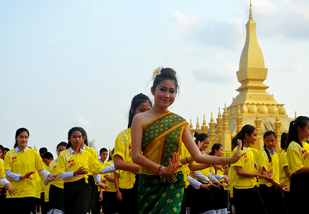 A Lao girl in traditional costume dancing Lam Vong Dance Lao Dance