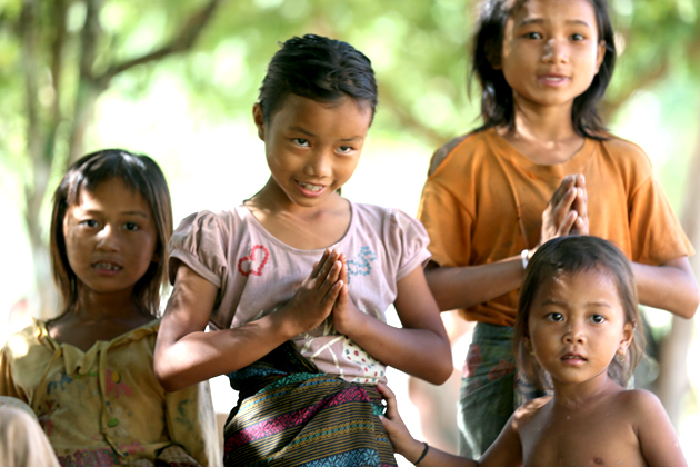 """Laotian people say """"Sabaidee"""" and bow with clasped hands in front of chest"""