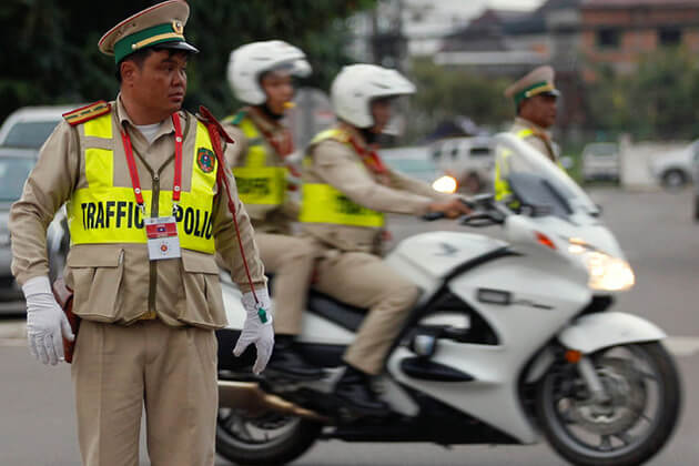 Laos-traffic-police, Laos tours