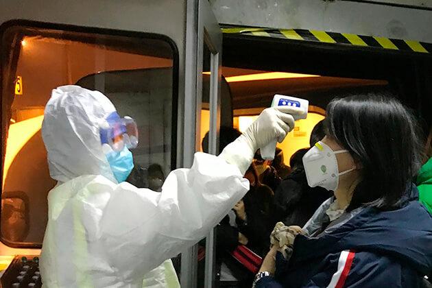 Laos authorities step up virus screening measures at borders